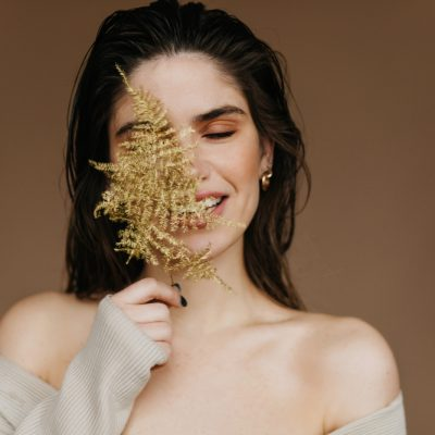 dreamy-young-woman-with-nude-makeup-posing-with-plant-close-up-portrait-ecstatic-black-haired-girl-chilling